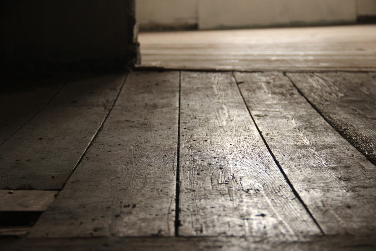 Worn floorboards on second floor landing