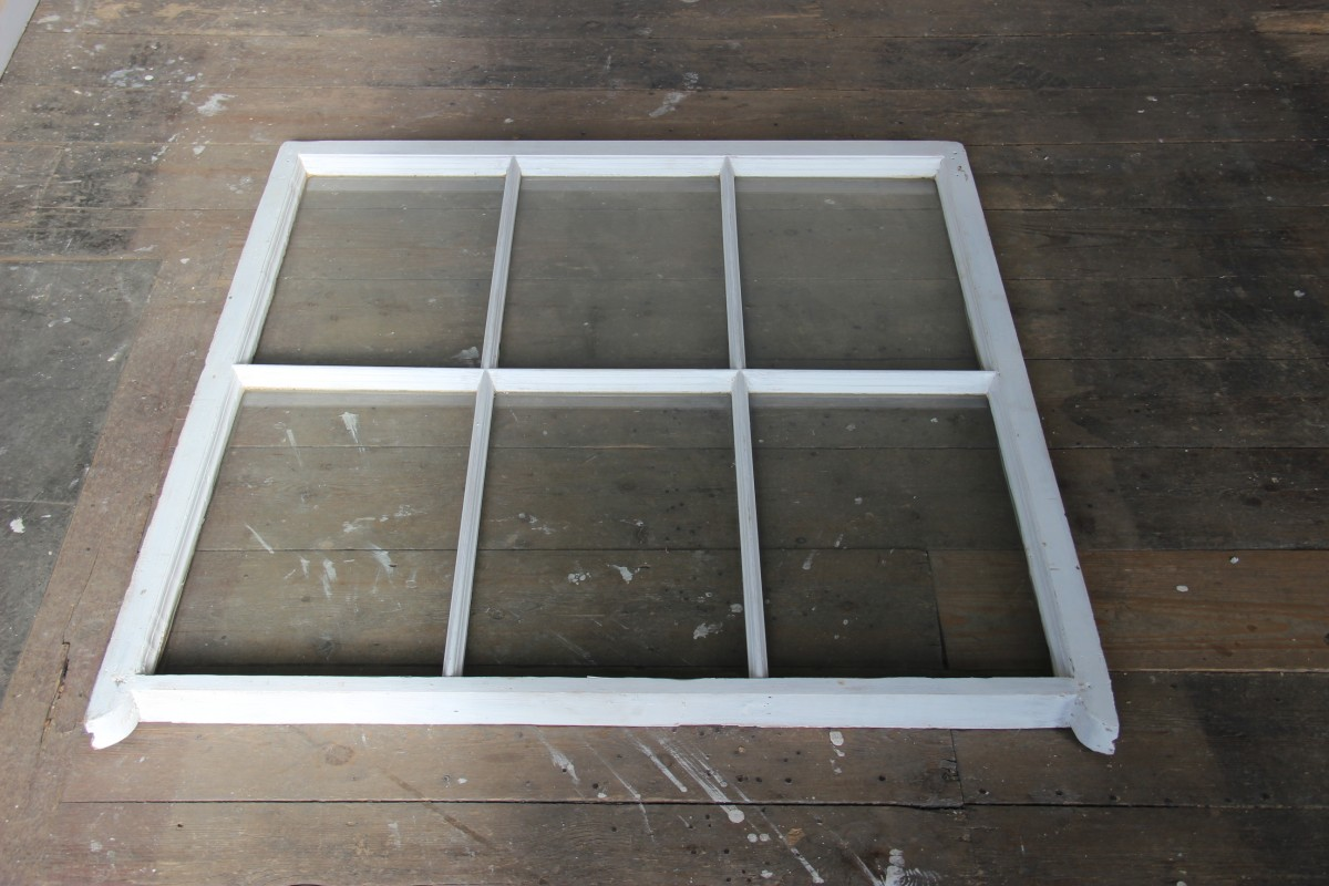 Typical 1840s sash window with concave 'horns' and lambstongue glazing bars under repair