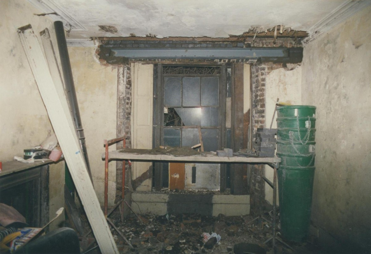 Rear room under renovation in the 1990s showing replacement window head