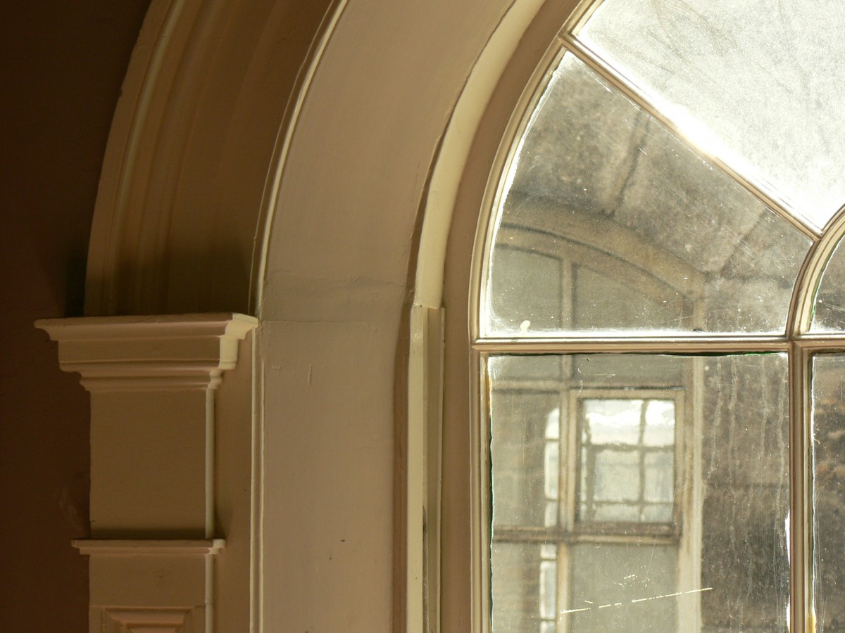 Restored arched stairwell window